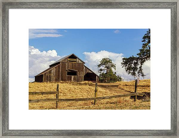 Barn With Fence In Foreground Framed Print