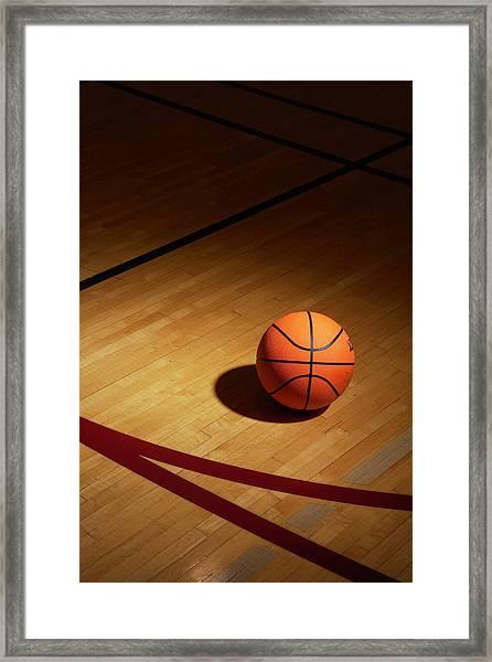 Basketball On Basketball Court Framed Print
