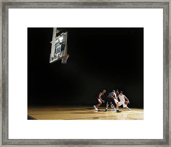 Basketball Players Playing On Court Framed Print