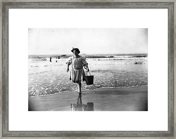 Bathing Hut Attendant Framed Print
