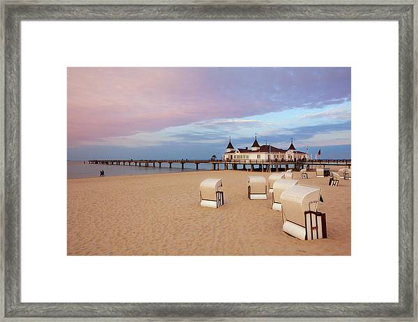 Beach Chairs And Pier In The Evening Framed Print