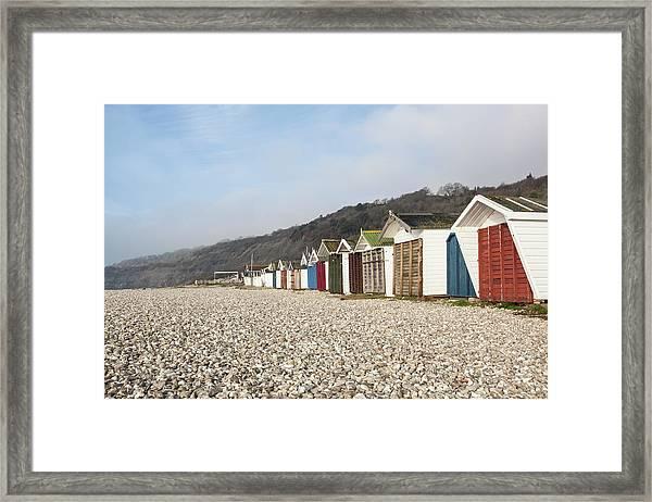 Beach Huts At Lyme Regis, Dorset Framed Print