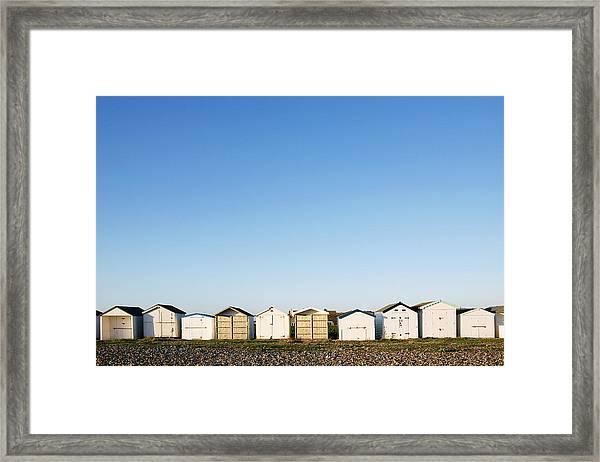 Beach Huts In A Row Framed Print
