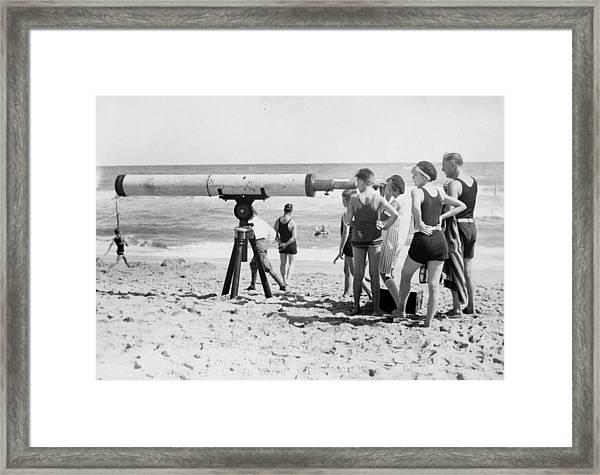 Beach Telescope Framed Print