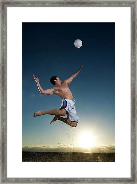 Beach Vollyball Player Serving At Sunset Framed Print