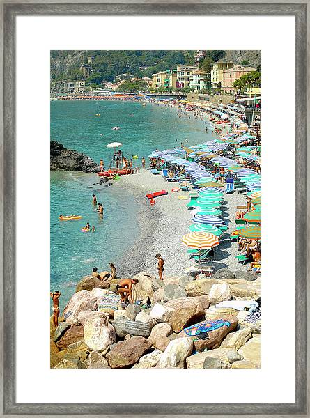 Beach With Holidaymakers, Rocks And Framed Print