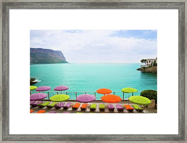 Beach With Parasol In Cassis, France Framed Print