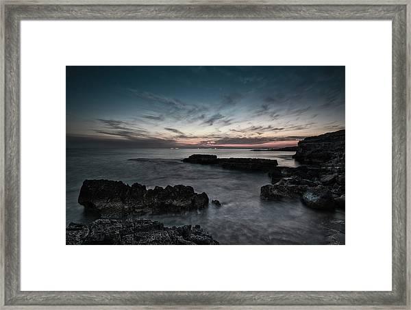 Beautiful Dramatic Sunset On A Rocky Coastline Framed Print