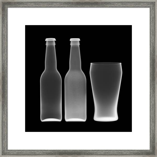 Beer Bottles And Drinking Glass Framed Print by Nick Veasey