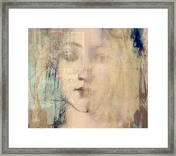 Behind The Painted Smile  Framed Print
