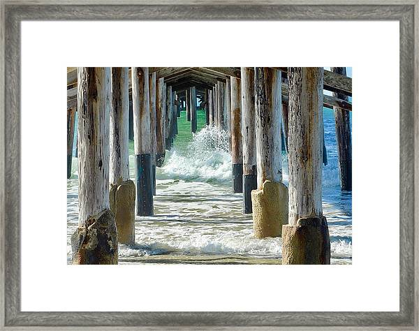 Below The Pier Framed Print