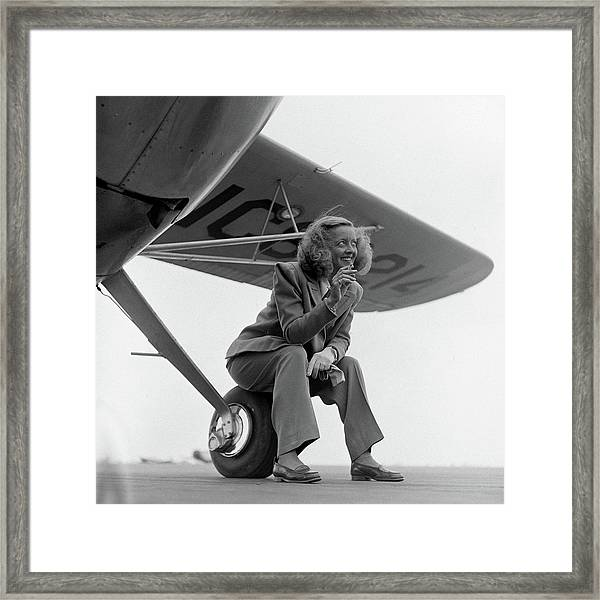 Bette Davis With Airplane, 1947 Framed Print