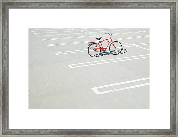 Bike In Empty Parking Lot Framed Print