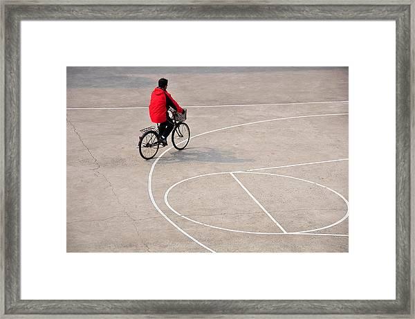 Biker On The Basketball Court Framed Print