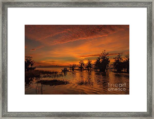 Framed Print featuring the photograph Blue Cypress Sunrise With Boat by Tom Claud