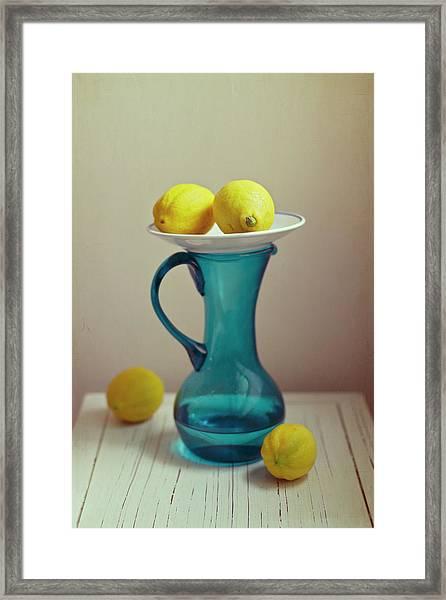 Blue Pitcher With Lemons On White Plate Framed Print