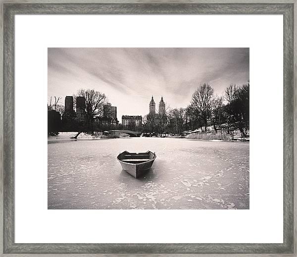 Boat On Frozen Pond In Central Park Framed Print