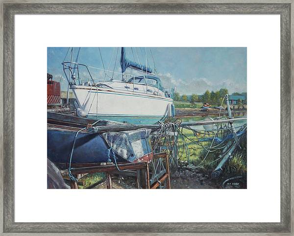 Boat Out Of Water With Dumped Parts At Marina Framed Print by Martin Davey