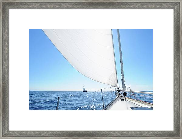 Boat Sailing Towards The Horizon Framed Print
