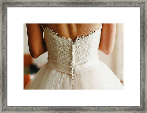 Bride Getting Ready, They Help Her By Buttoning The Buttons On The Back Of Her Dress. Framed Print