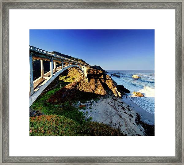 Bridge Spanning A Valley Next To The Sea Framed Print
