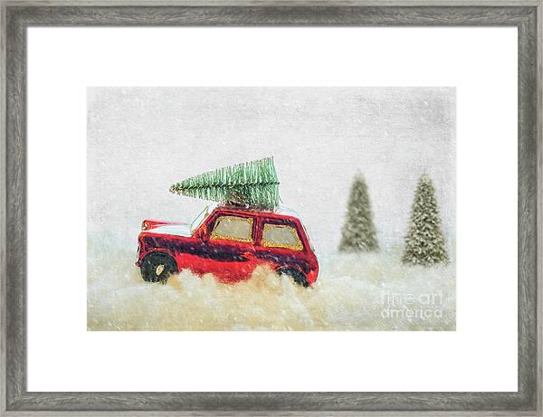 Bringing Christmas Home Framed Print
