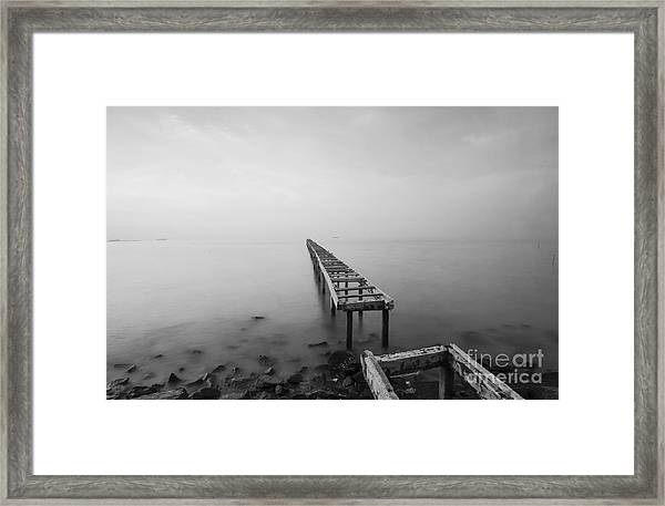 Broken Wood Bridge And Waves Crashing Framed Print by Nelzajamal
