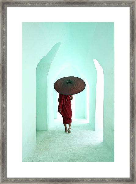 Buddhist Monk Walking Along Arched Framed Print