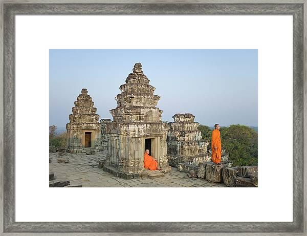 Buddhist Monks Amongst Temple Ruins Framed Print