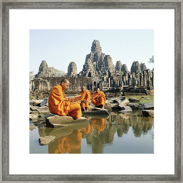 Buddhist Monks Sitting In Front Of Framed Print