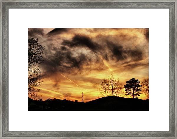 Burning Clouds Framed Print