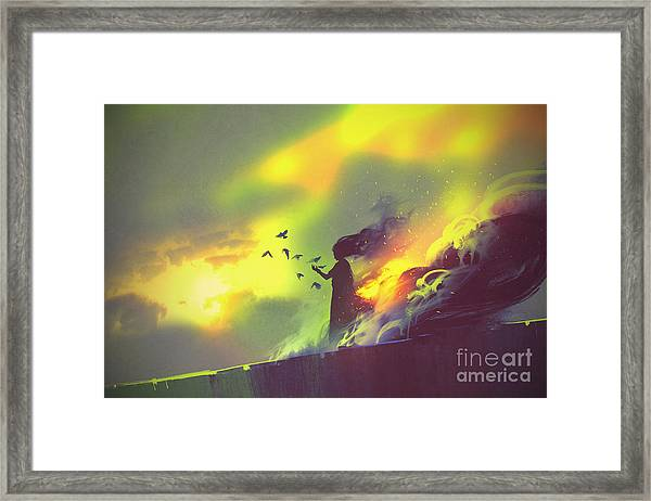 Burning Woman Standing Against Cloudy Framed Print