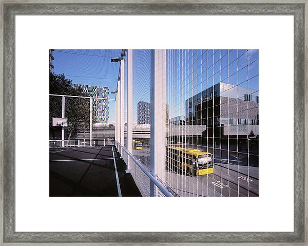 Bus Passing Elevated Basketball Court Framed Print