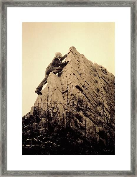 Businessman Climbing Jagged Rock, Low Framed Print