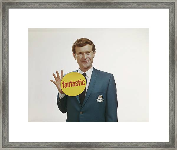 Businessman Holding Sign, Smiling Framed Print