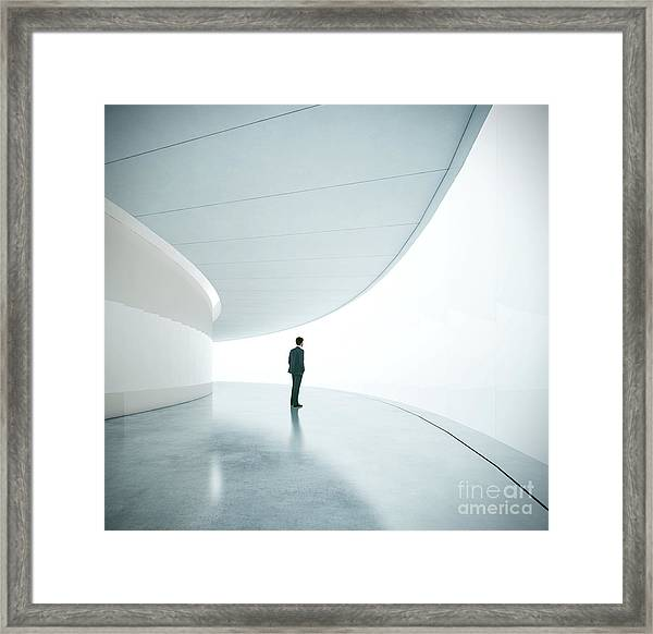 Businessman In Front Of Wide White Framed Print