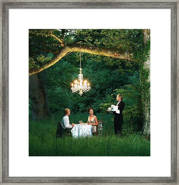 Butler Waiting On Young Couple Dining Framed Print