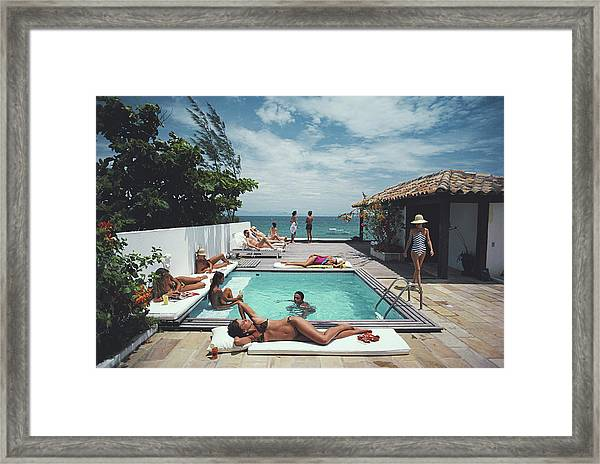 Buzios Framed Print by Slim Aarons
