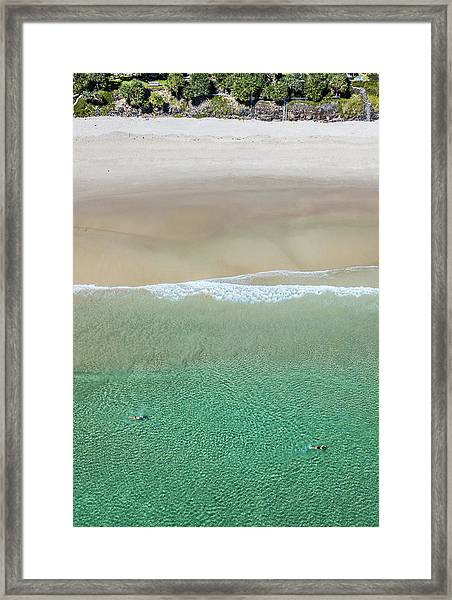 Framed Print featuring the photograph Byron Bay Swimmers by Chris Cousins