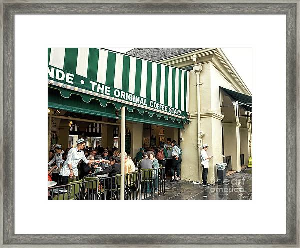Cafe Du Monde Situation In New Orleans Framed Print by John Rizzuto