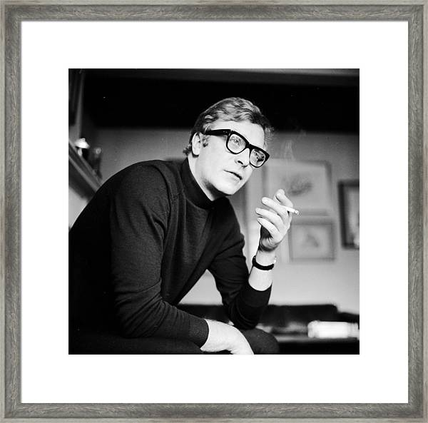 Caine Smoking Framed Print