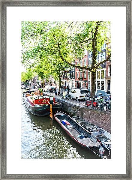 Canal Boats In Amsterdam Framed Print