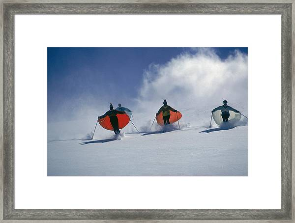 Caped Skiers Framed Print