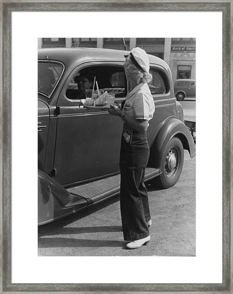 Carhop Picking Up Tray From Driver Of Au Framed Print