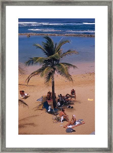 Caribe Hilton Beach Framed Print by Slim Aarons