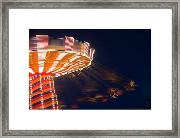 Carnival Ride Framed Print by By Ken Ilio