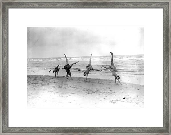 Cartwheels Framed Print by Fox Photos