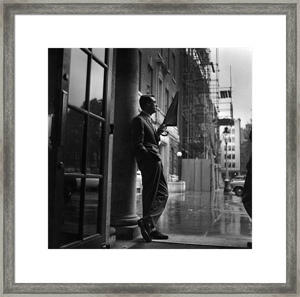 Cary In Rain Framed Print