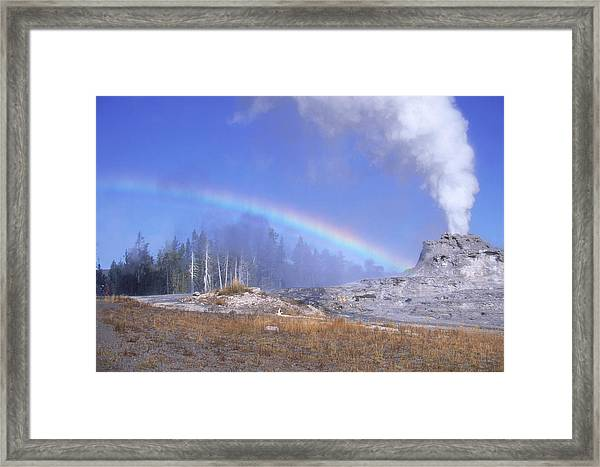 Castle Geyser And Rainbow Framed Print by David Hosking
