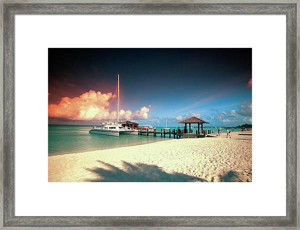 Catamaran Docked At Pier At Sunset On Framed Print